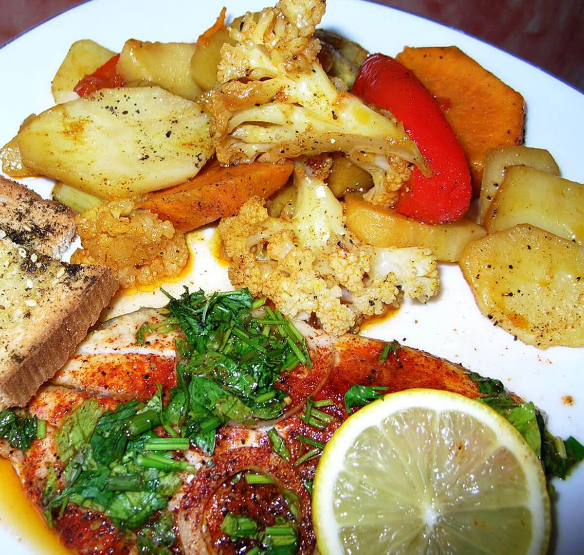 Oven baked tilapia fillets with silan steamed vegetables for How to bake tilapia fish in the oven